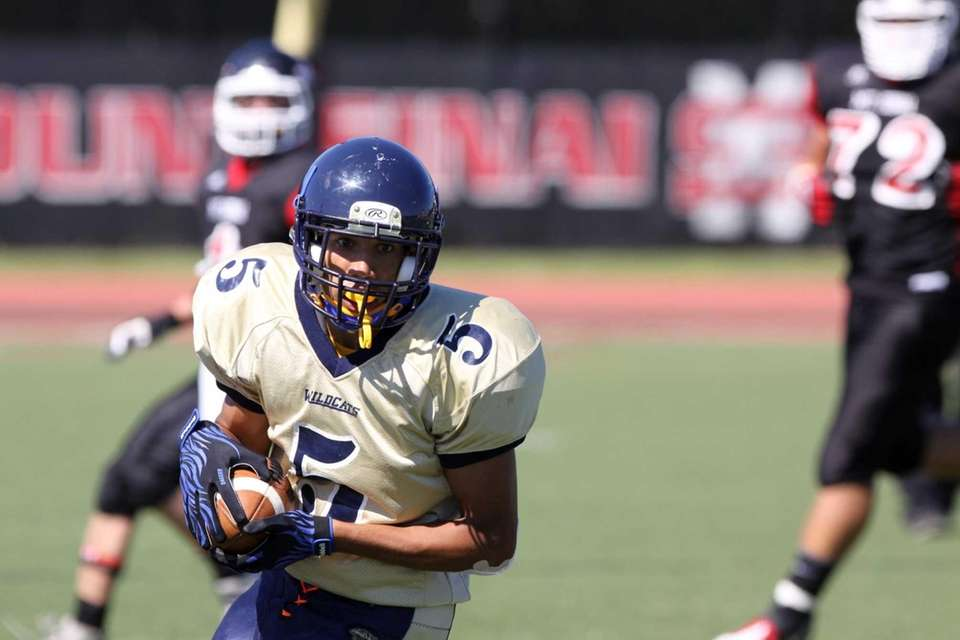 Shoreham-Wading River's Isreal Squires runs the ball during