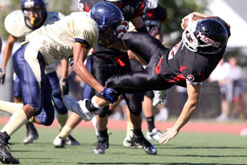 Mt. Sinai's Zach Wolfe, right, is tackled by