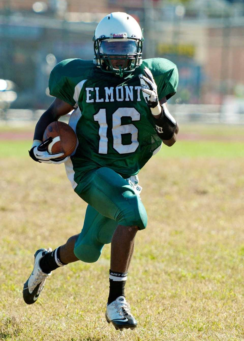 Elmont wide receiver Paul Jean runs for a