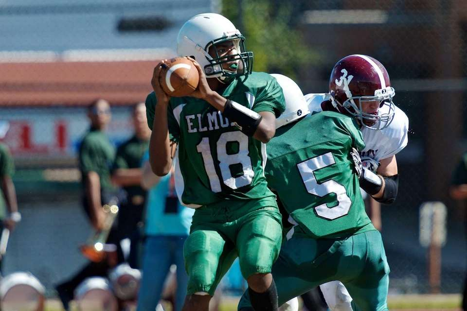 Elmont quarterback James Bailer attempts a pass during