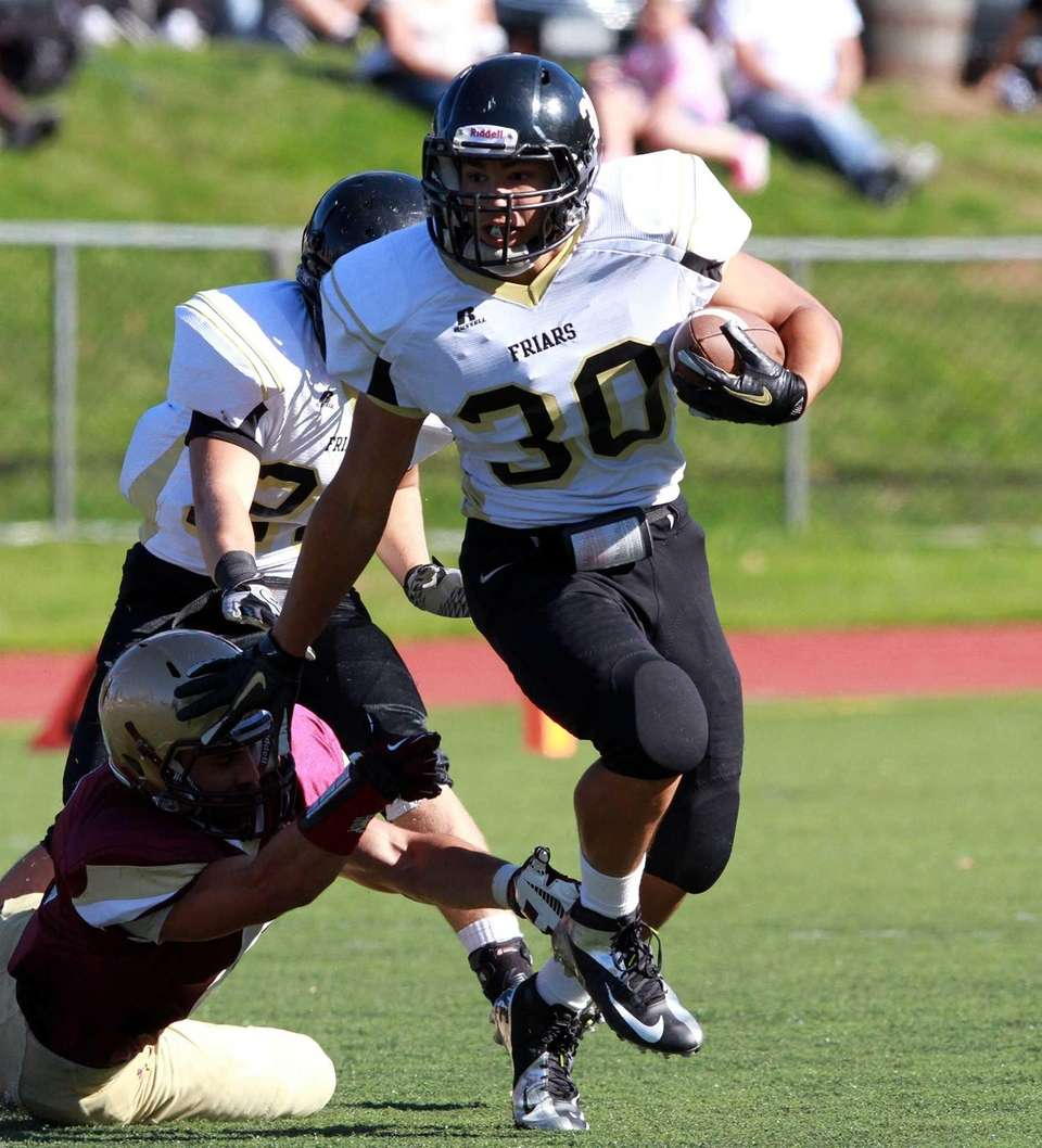 St. Anthony's Brendan Femiano scores a touchdown during