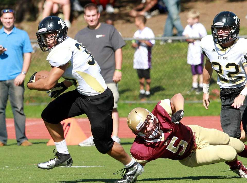 Iona Prep's Kyle Bonci tries to tackle St.