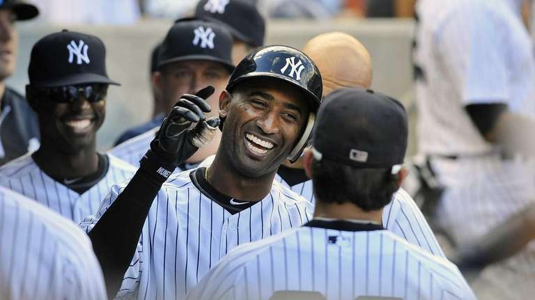 Eduardo Nunez smiles as he is greeted in