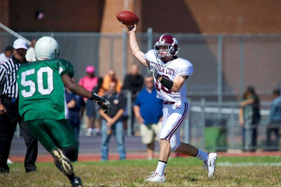 Garden City quarterback Brett Stewart attempts a pass