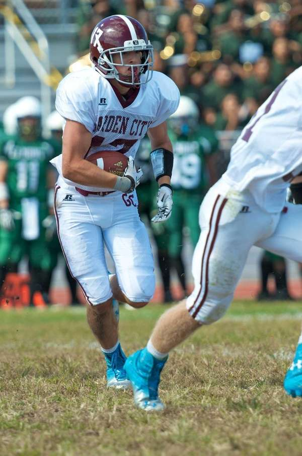 Garden City wide receiver Justin Guterding runs upfield