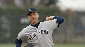 Then-45-year-old veteran left-hander Tommy John delivers a pitch