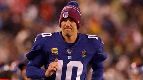 Eli Manning of the Giants runs to the