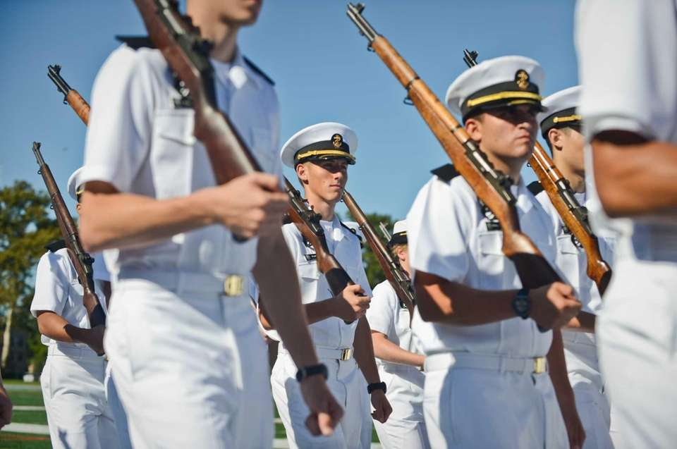 Freshman students are sworn in by Rear Admiral