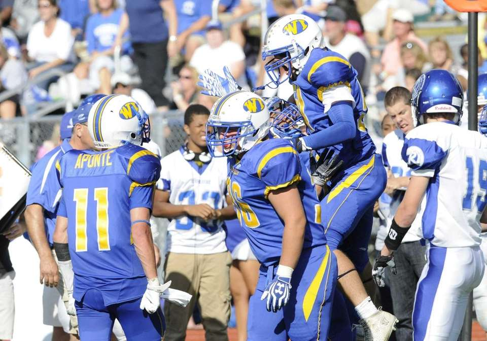 West Islip palyers celebrate a turnover. (Sept. 15,
