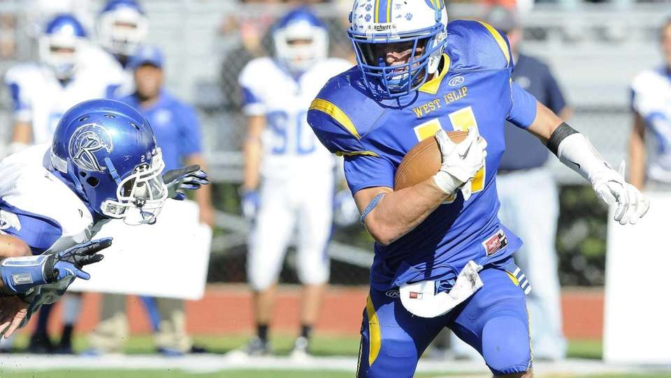 West Islip's Nick Aponte escapes a tackle by