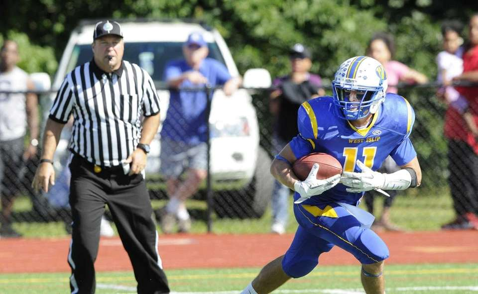 West Islip's Nick Aponte carries the ball after