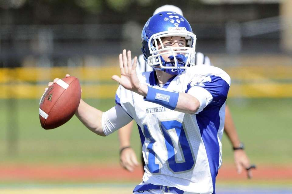 Riverhead quarterback Ryan Blitzer passes during a Suffolk