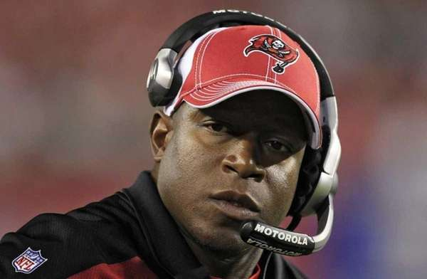 Then-Buccaneers head coach Raheem Morris watches as time