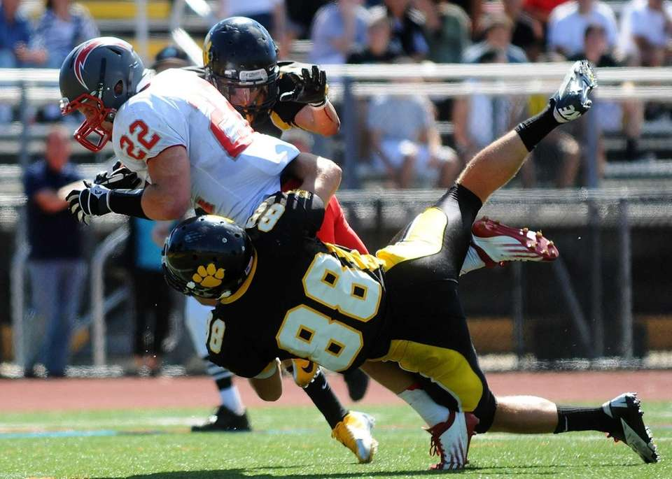 Connnetquot High School running back Ryan Harvey scores