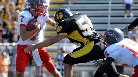 Connnetquot quarterback Brian McKean, left, protects the ball