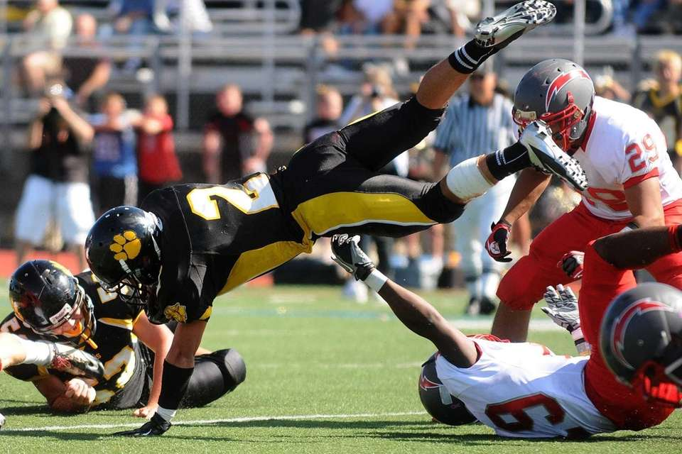 Commack's Willy Monroy makes a crash landing after