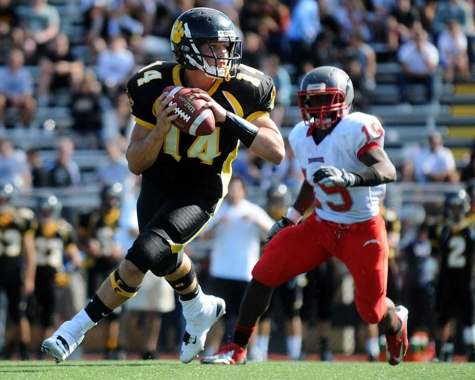 Commack quarterback Ryan Heizman rolls to his right