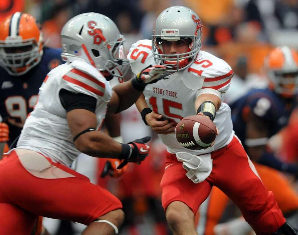 Stony Brook quarterback Kyle Essington hands off to