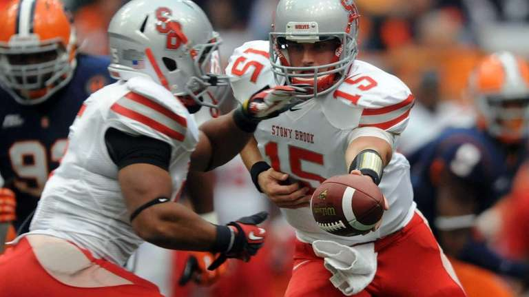 Stony Brook quarterback Kyle Essington hands off to