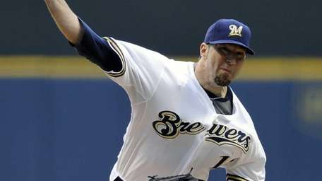 Shaun Marcum pitches in a game against the