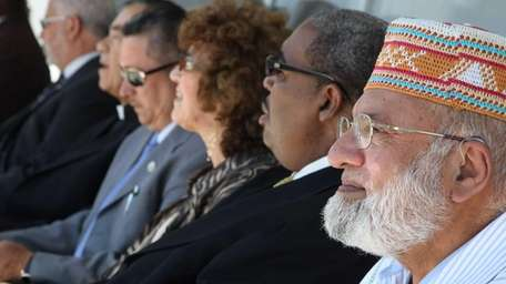 Hafiz Rehman, right, sits with other clergy at