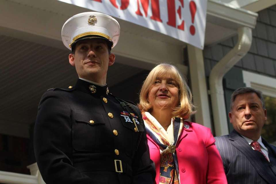 Marine Capt. James Byler with his parents, Janet