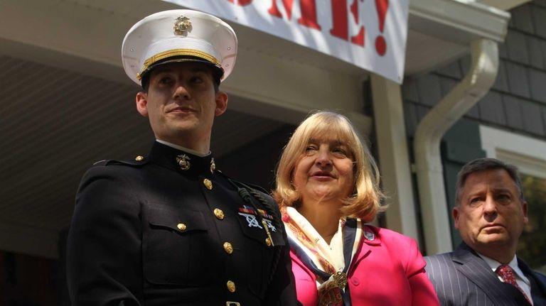 Marine Capt. James Byler with his parents, Janet