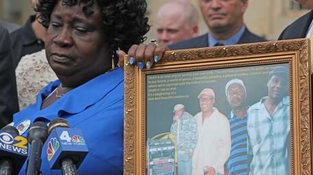 June Facey, wife of Raymond Facey, speaks to