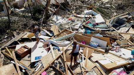 Two women look for lost items after Hurricane