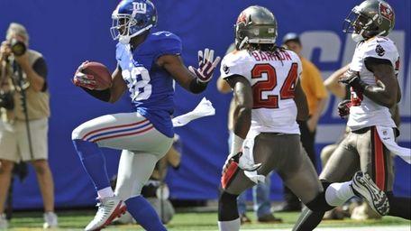 Giants wide receiver Hakeem Nicks (88) runs past