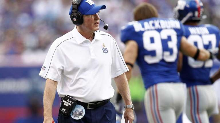 Tom Coughlin watches from the sidelines during a