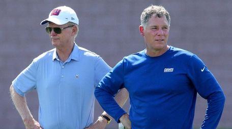 Giants co-owner John Mara, left, said after firing