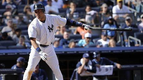 Derek Jeter reacts after he struck out swinging