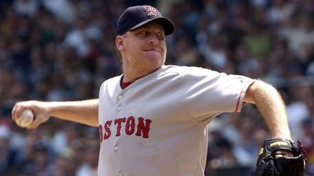 Curt Schilling of the Red Sox pitches in