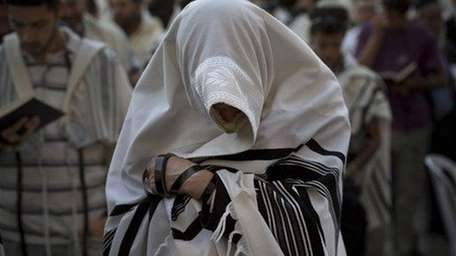 Ultra-Orthodox Jews pray at the Western Wall in