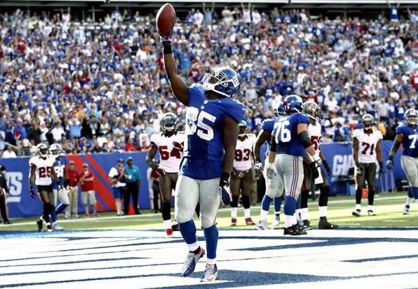 Andre Brown celebrates a touchdown against the Tampa