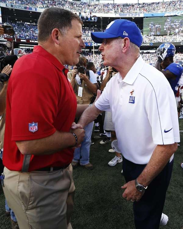 Tampa Bay Buccaneers head coach Greg Schiano, left,