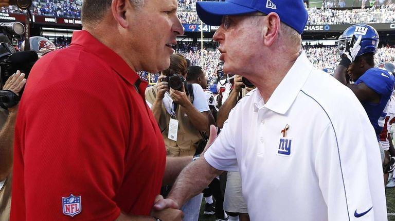 Tampa Bay Buccaneers head coach Greg Schiano, left,