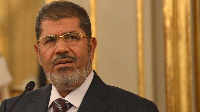 Egypt President Mohamed Morsi speaks during a press
