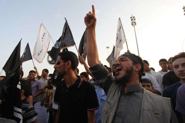 Libyan followers of the Ansar al-Shariah Brigades chant