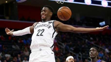 Nets guard Caris LeVert dunks against the Pistons