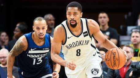 Nets guard Spencer Dinwiddie brings the ball downcourt