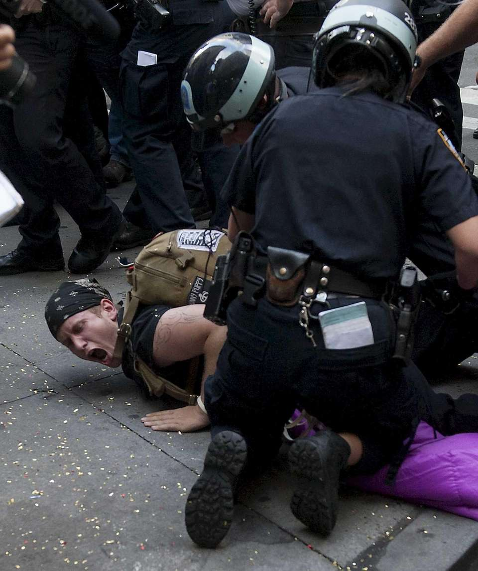 New York City police officers detain supporters of