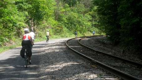 Bicyclists embark on the long descent into Cumberland,