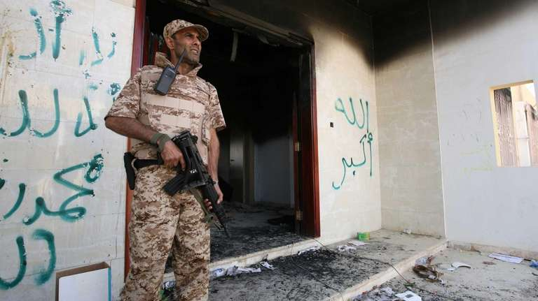 A Libyan military guard stands in front of