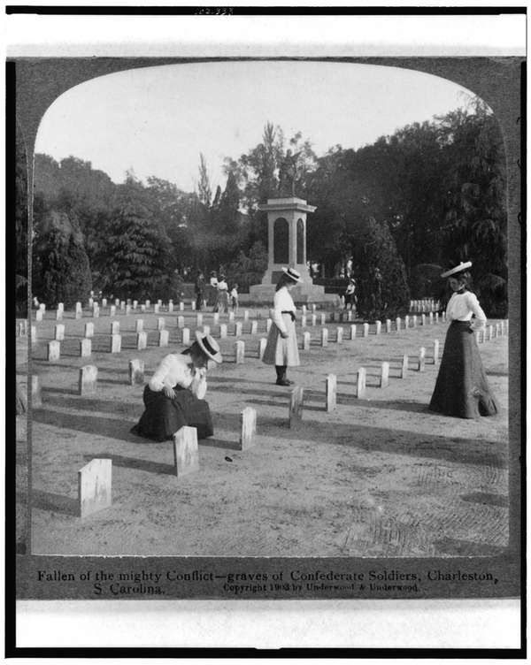 Three women looking at graves in the Confederate