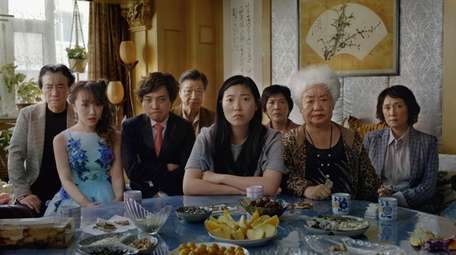 This image released by A24 shows Awkwafina, center,