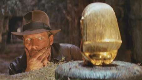 Indiana Jones eyes a golden idol in the