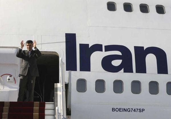 Iranian President Mahmoud Ahmadinejad waves as he boards