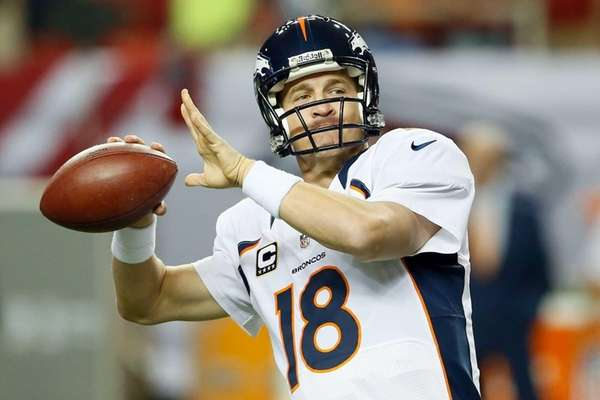 Quarterback Peyton Manning of the Denver Broncos warms